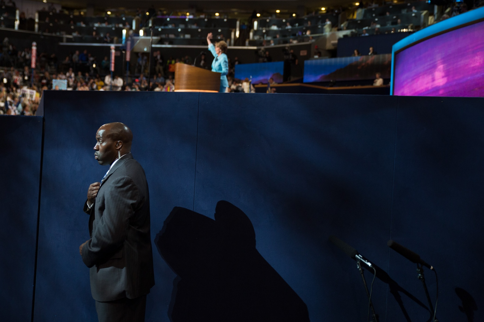 A member of the security detail as House Minority Leader Rep. Nancy Pelosi (D- Ca.) speaks during the 2012 Democratic National Convention .