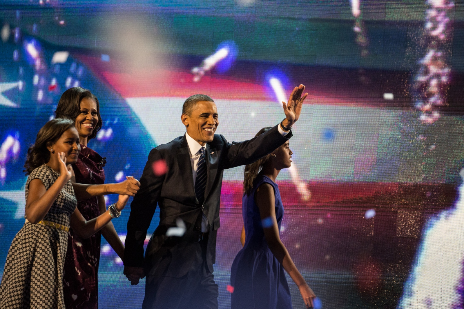 Sasha, First Lady Michelle Obama, President Barack Obama and Malia wave to the crowd at the 2012 Democratic National Convention after Obama's speech.