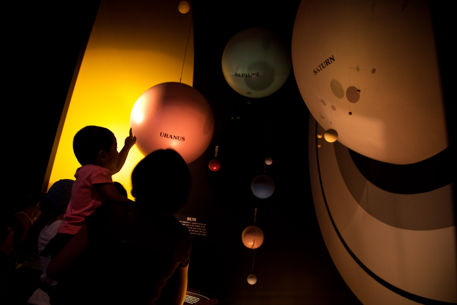 Visitors view scaled models of the planets in our solar system at the Smithsonian Air and Space Museum during the 40th Anniversary of the Apollo 11 mission that landed the first humans on the moon.