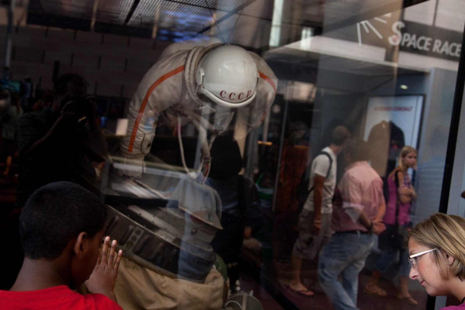 Visitors look at a space suit worn by Soviet cosmonauts.