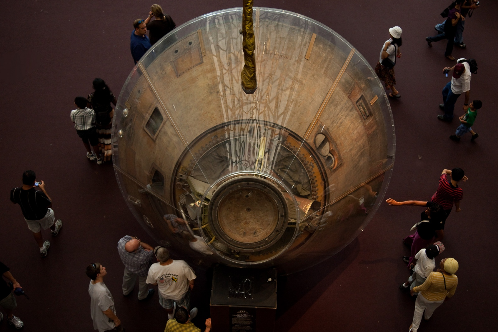 A tourist reaches out to touch the Apollo 11 command module on view at the museum during the 40th Anniversary of the Apollo 11 mission that landed the first humans on the moon.