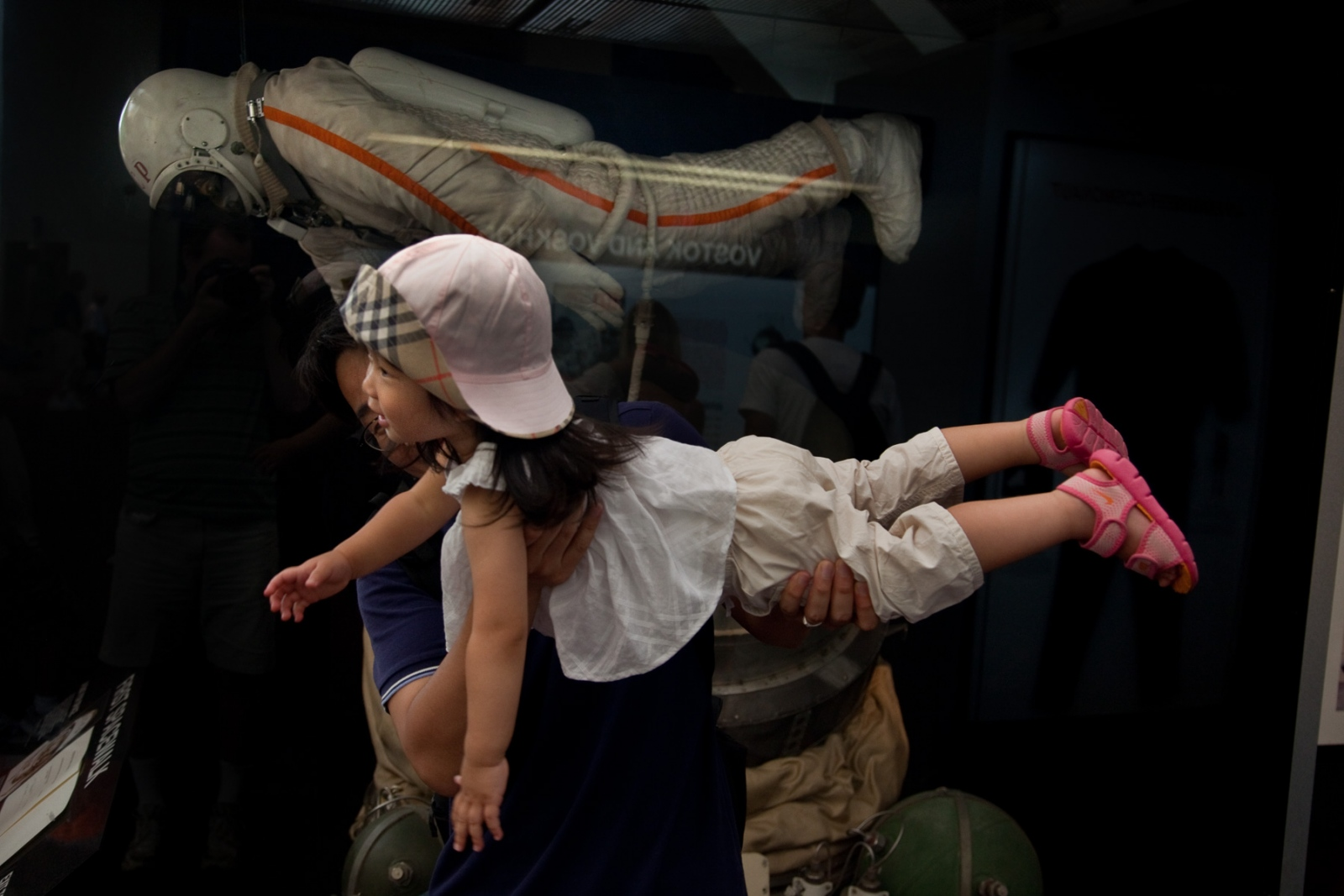 A father shows his daughter what it must feel like to float in space at the Smithsonian Air and Space Museum during the 40th Anniversary of the Apollo 11 mission that landed the first humans on the moon.