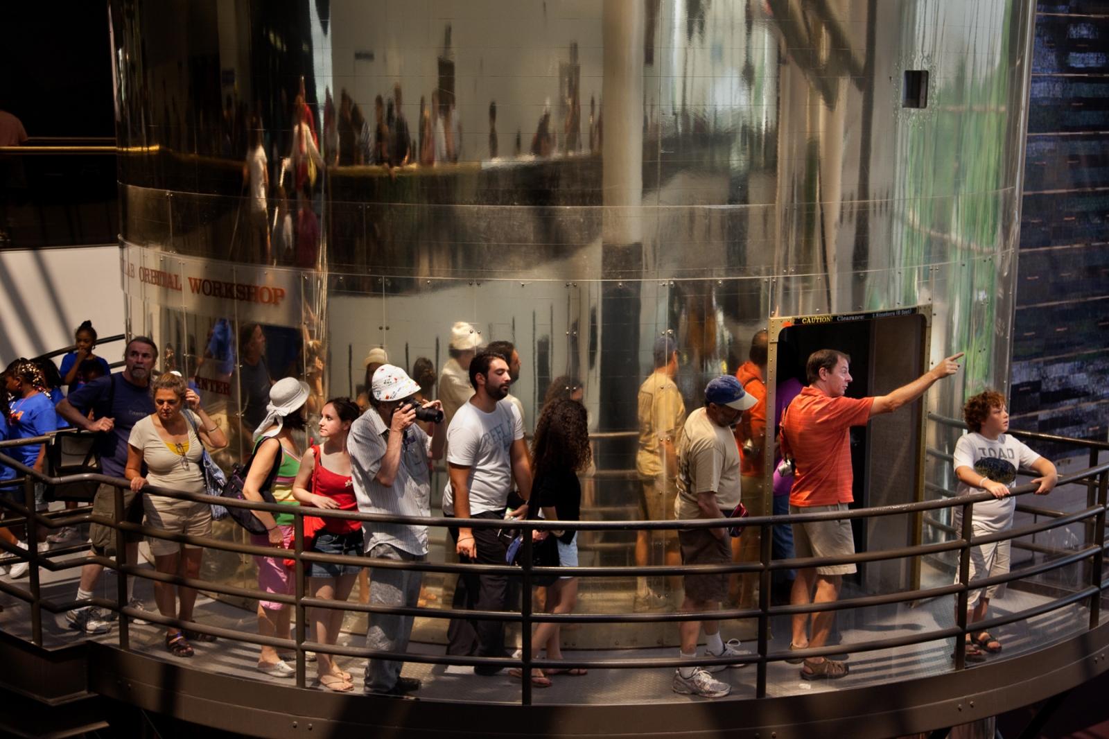 Visitors line up to go into the Skylab Oribtal Workshop (backup unit).