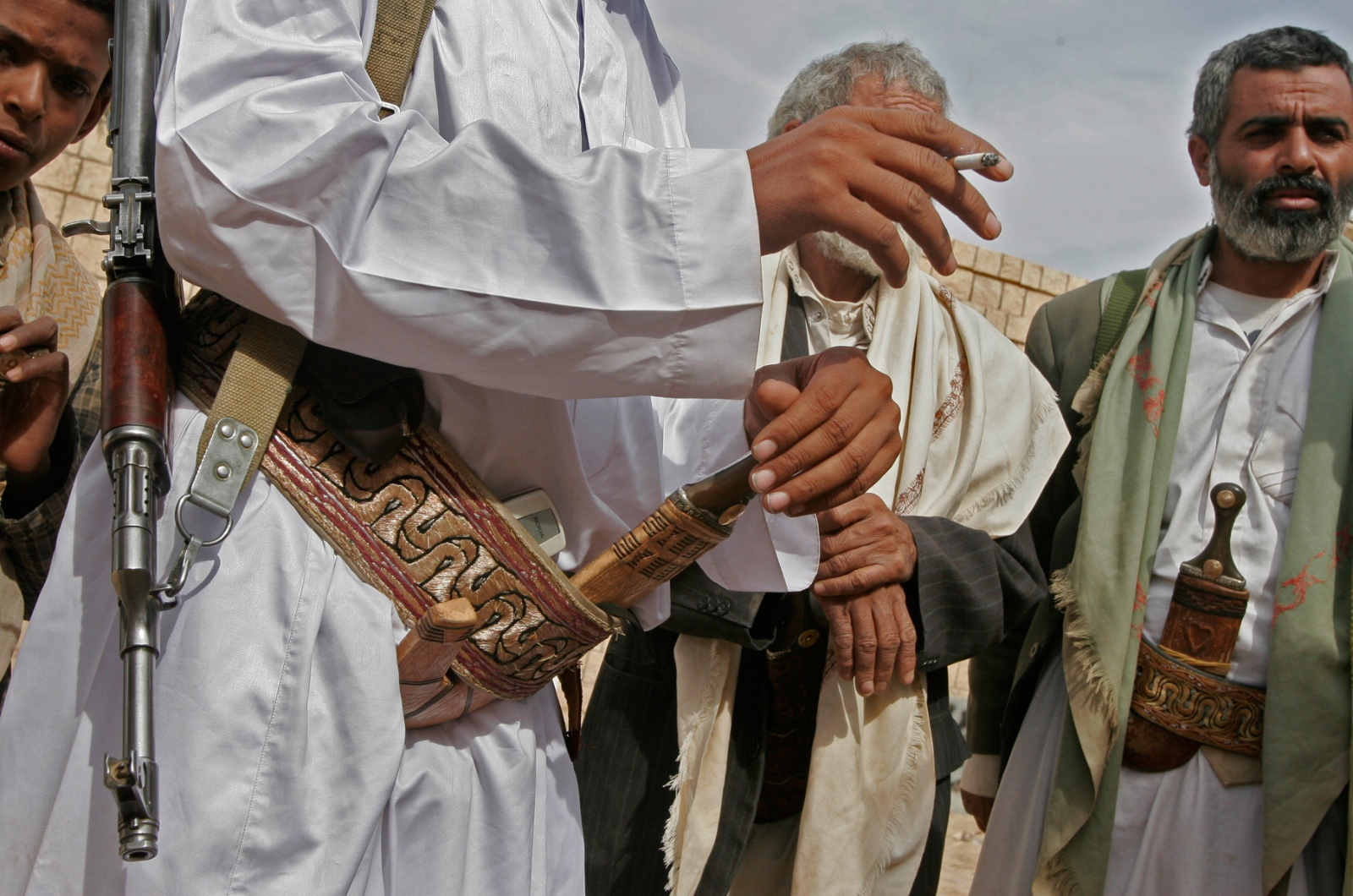 Sheik Rabea carries his gun, knife, and cell phone as he travels through Al Jawf to meet and talk with his tribesmen.