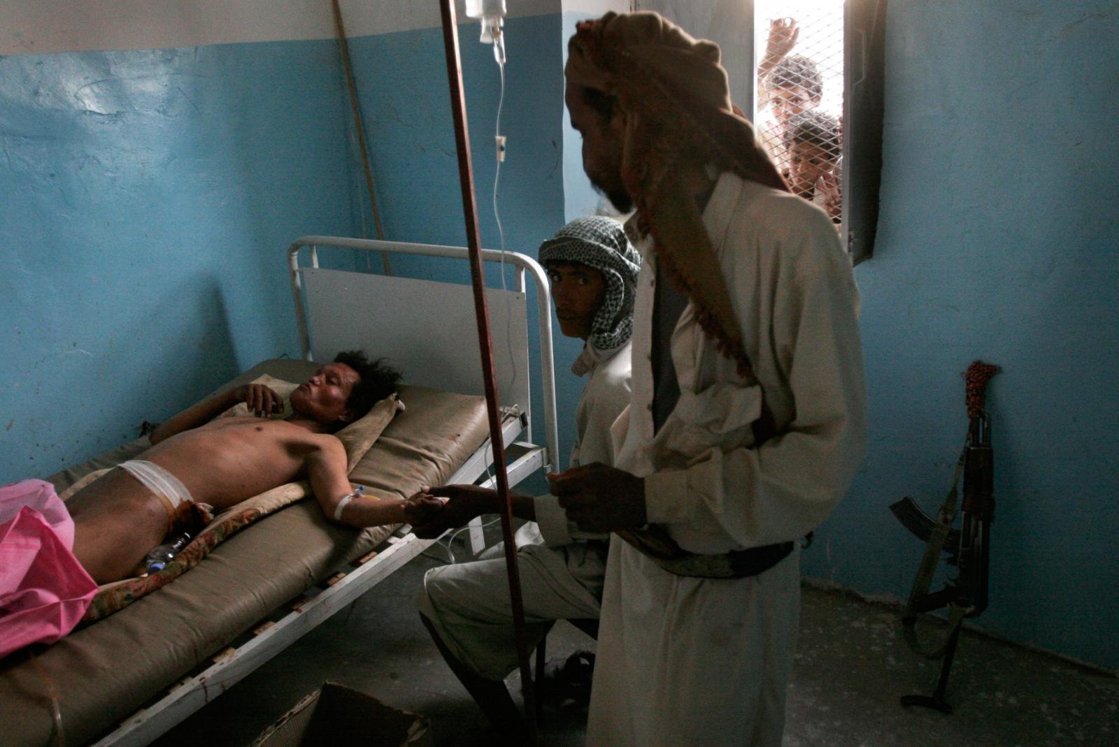 Family members watch over Sirhan bin Jaji Araban at a medical clinic in Mymerra. He was shot in a dispute that prompted by Sheik Rabea al-Okaimi's mediation efforts.