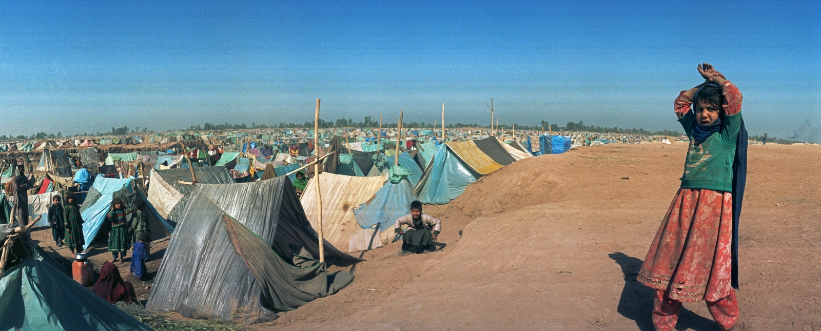 At Jalozai refugee camp, just over the border in Pakistan, grimy plastic sheets and rancid-smelling cloth are their only shelter.