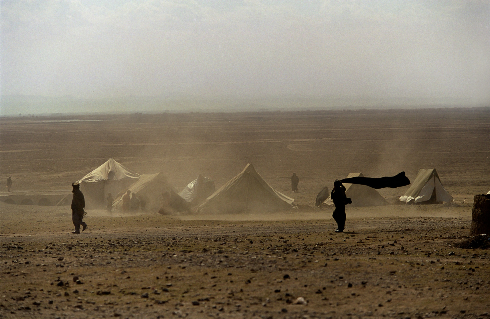 The refugees look in every direction and see nothing but wind, sand and mountains in the distance.