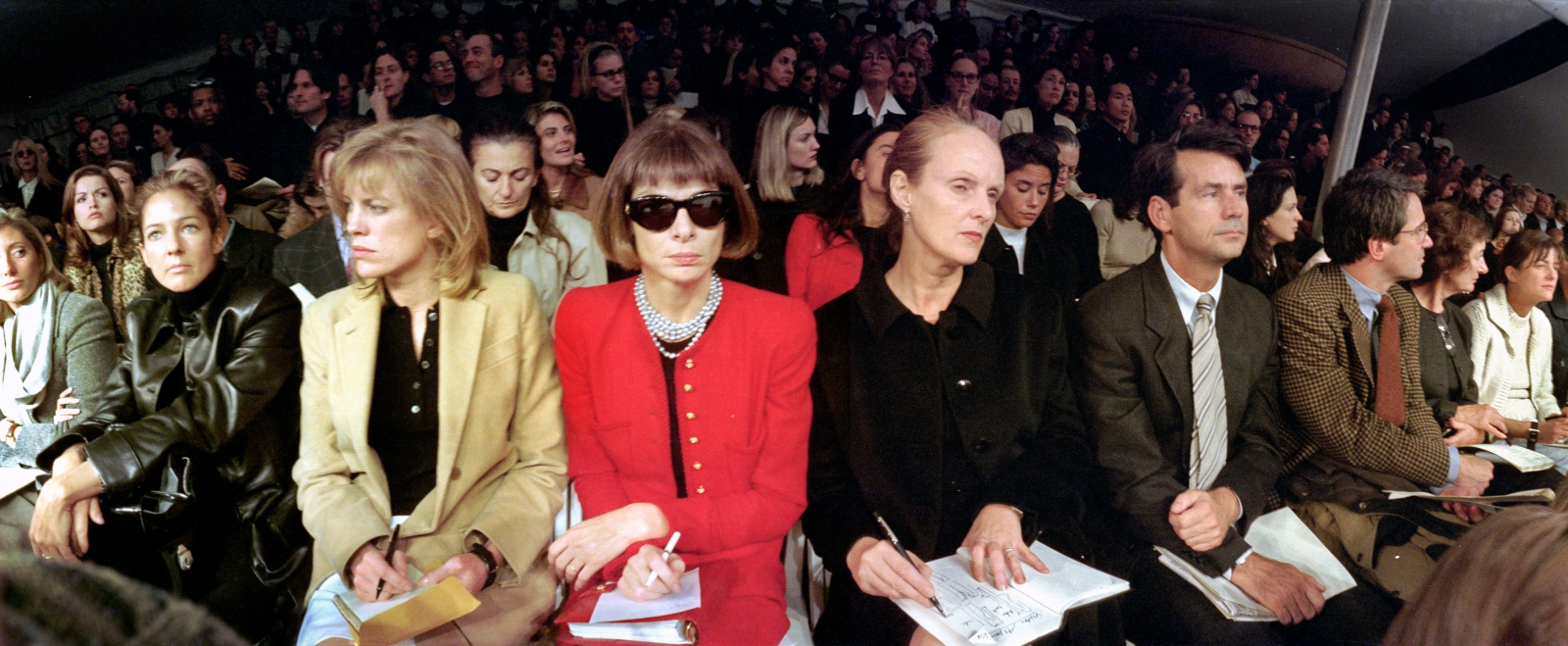 The Front Row: Photographer (and ex-Mrs. Calvin Klein) Kelly Klein (in black); Katherine Betts, Anna Wintour; and Grace Coddington of Vogue'; and Patrick McCarthy of Fairchild Publications. The line-up in the front row is an indication of who wields the power in the fashion industry, The seats are painstakingly assigned by the show's publicist. Fall '95.