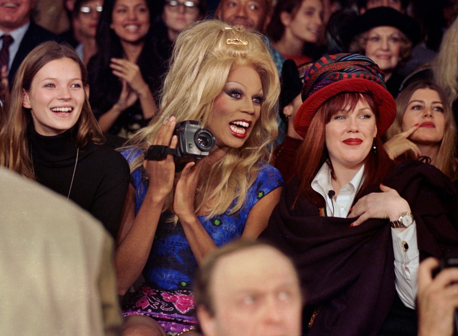 Kate Moss, RuPaul, and Tommy Boy's Monica Lynch. RuPaul stands out among drag queens because of her startling height, blonde wig, and fondness for designer clothes. She was once a regular at fashion shows but today is rarely seen at such events. Todd Oldham, fall '94.