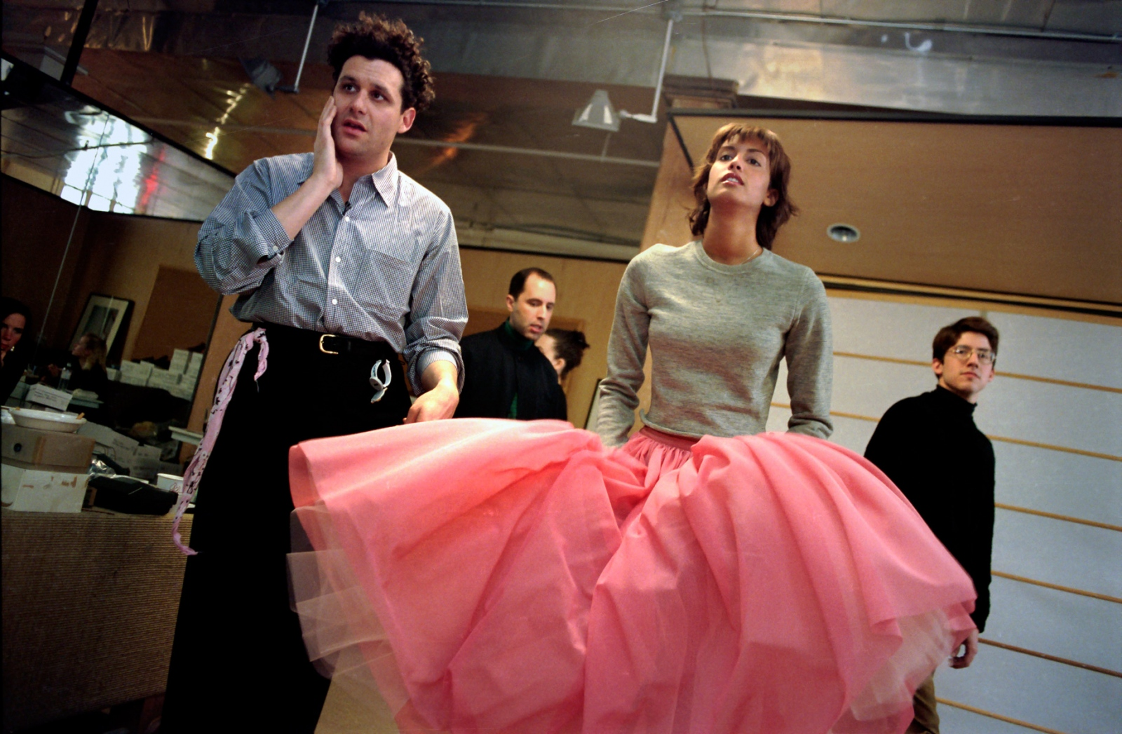 Designer Isaac Mizrahi does a last minute fitting on a voluminous evening skirt worn by model Yasmeen Ghauri. A model's fee for a show includes time spent at fittings. Spring '94.