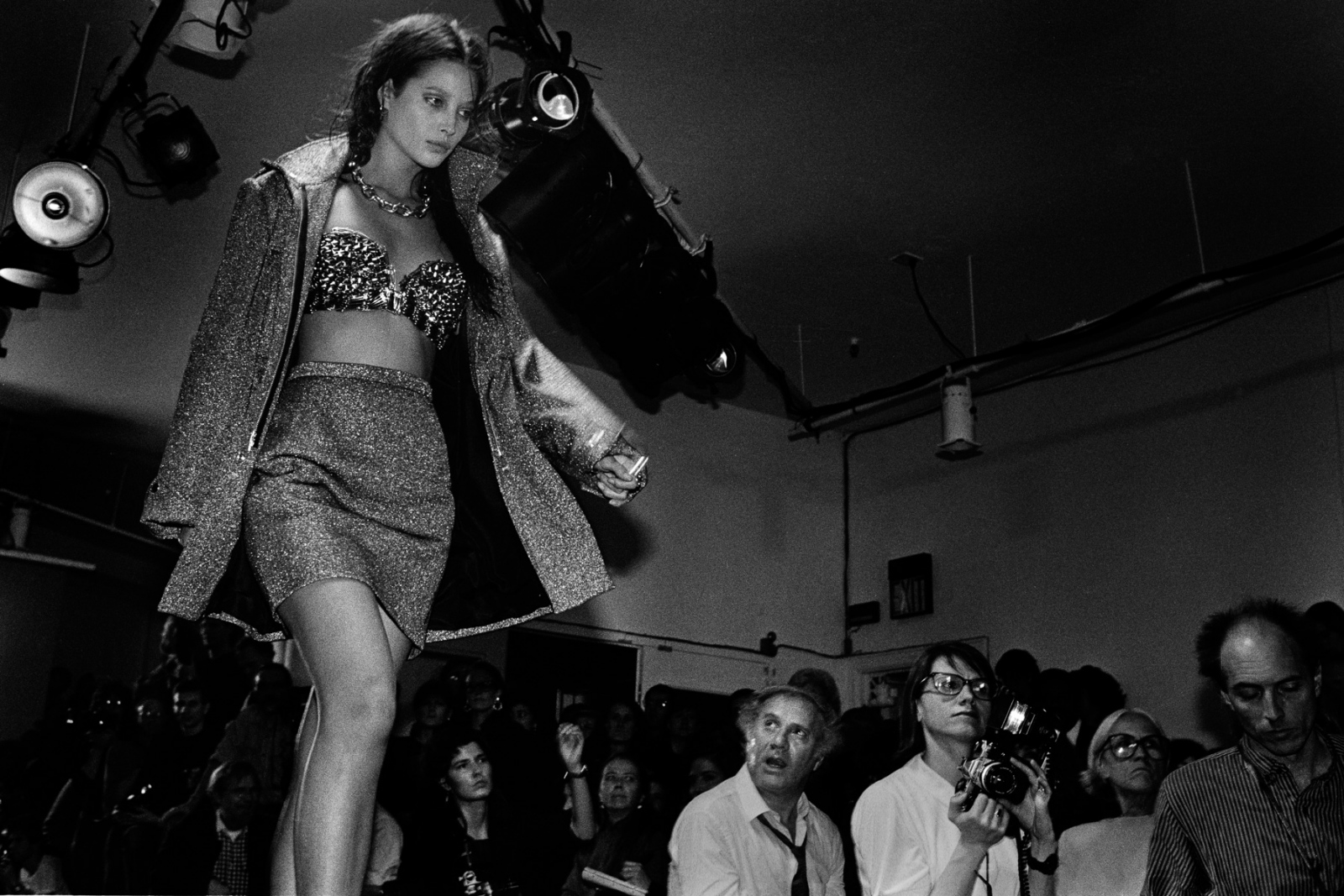 Christy Turlington walks an elevated runway in a cramped warehouse. Before he shows moved to Bryant Park in midtown, guests ran all over Manhattan to makeshift auditoriums. Once, bits of plaster fell from a crumbling ceiling onto an unsuspecting audience. Stephen Sprouse, fall '90.