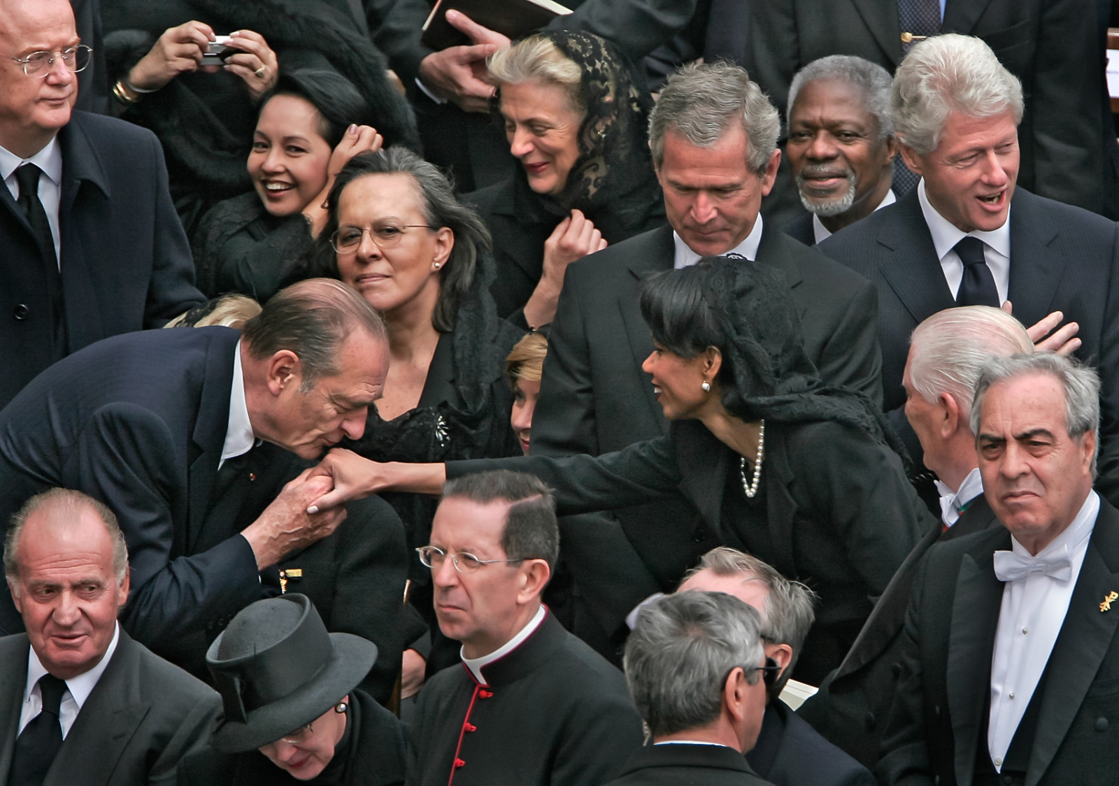 At the funeral of Pope John Paul II at the Vatican Sec. of State Condelezza Rice gladly accepts a kiss by French President Jacques Chirac.