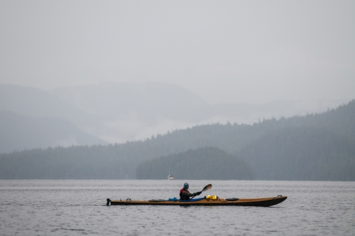 A kayaker paddles in the bay a mile of shore from Sitka, AK. Sept 27, 2009.