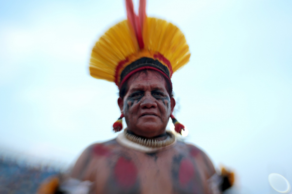 "Tabata - Kuikuro - Brazil  The Kuikuro live in the National Park of Xingu, in the area known as the High Xingu, in Mato Grosso. They are divided into 3 villages: Ahukugi Lahatuá, e a principal, Ipatse. In 2011, a study conducted by Ipeax counted 522 individuals in this population. The first contact with non-indigenous people is recorded in the documents of the Anthropologist and Exploiter Doctor Karl Von Den Steinen, in 1884 and 1887. Steinen is recalled in the Kuikuro narratives as Kalusi, the first white (kagaiha), that came in peace, bringing gifts and goods to exchange. The Kuikuro received this name from Karl Von Den Steinen that tried to register the speakers of the Karíb language from the Kuhikugu village habitants. The self denomination is always given by the local name or the name of the village, following the term ótomo, ""owners or masters"", for example ""Ipatsee ótomo,"" in other words, owners of Ipatsee."