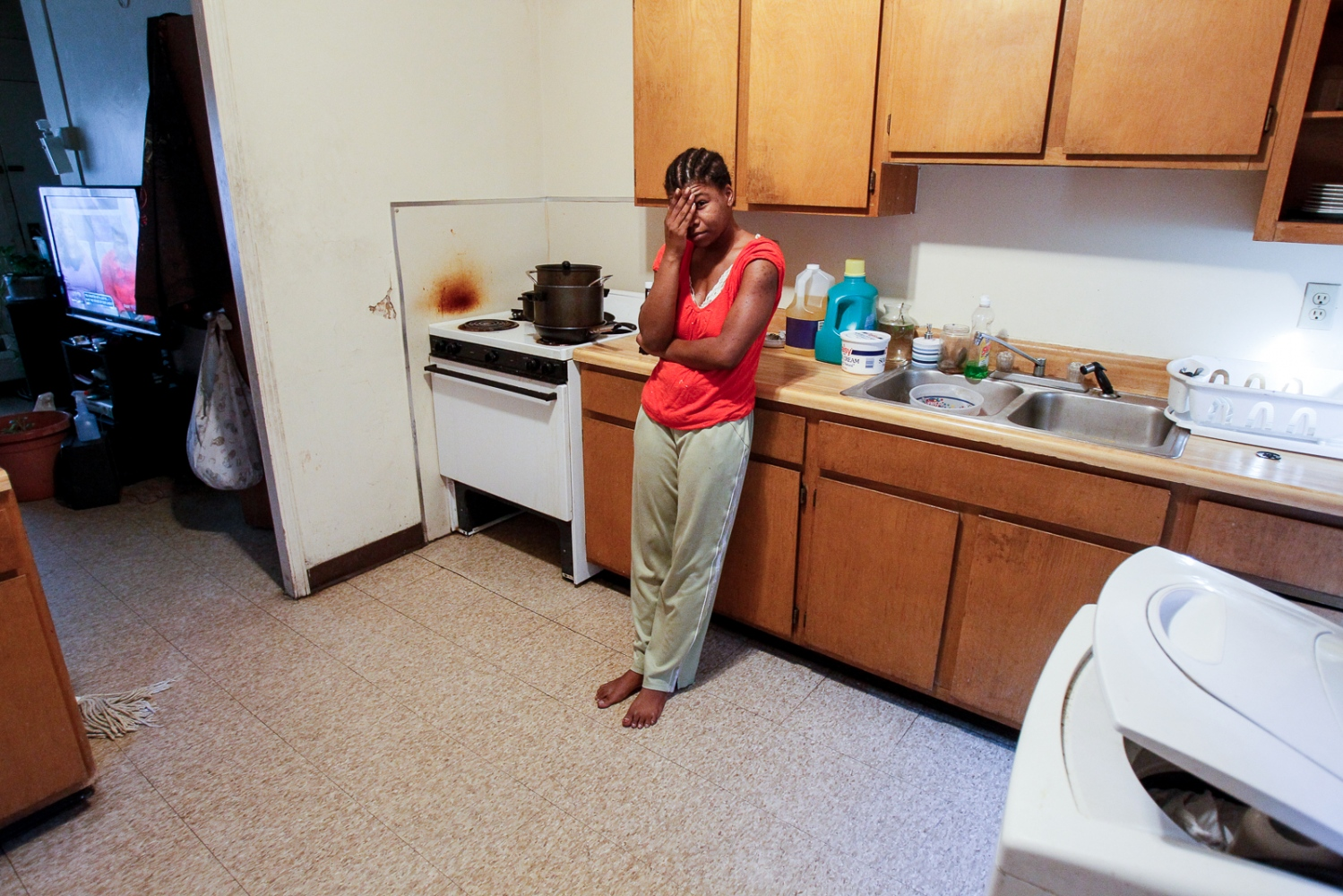 Denisha Jacobs stands in her kitchen at the Brand Whitlock homes on Friday, Nov. 18, 2011.