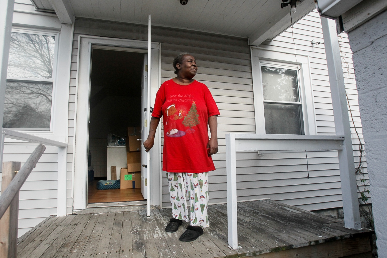 Pauline Watley stands on her new home's back porch on Saturday, Dec. 12, 2011.