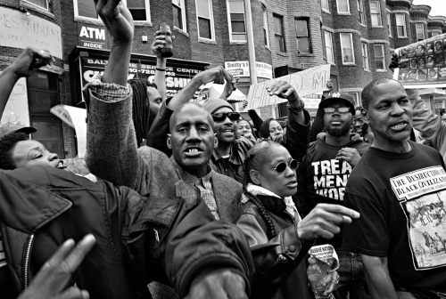 Baltimore, Md-Protesters on the streets celebrate criminal charges filed against the six police officers involved in the death of Freddie Gray.