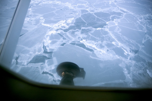 View of the Alaskan tundra from the small airplane on the way to Shishmaref. During the winter season, planes are the only practical way of transportation to and from the Village to other villages and to the mainland Alaska.