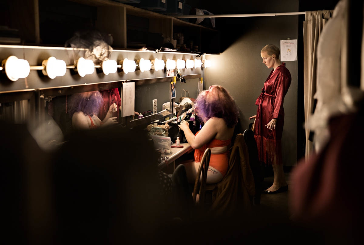A moment of Zen: Blocking out any backstage chaos, Red Hot Annie visualizes her act before taking the stage. Burlesque acts are a labor of love with each performer designing every aspect of their act: choreography, costume, makeup and accessories.