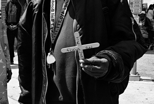 Baltimore, MD- A protester holds out his makeshift sign of his faith.