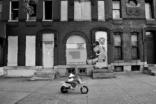 Baltimore, MD-A young child testing his electric motorcycle
