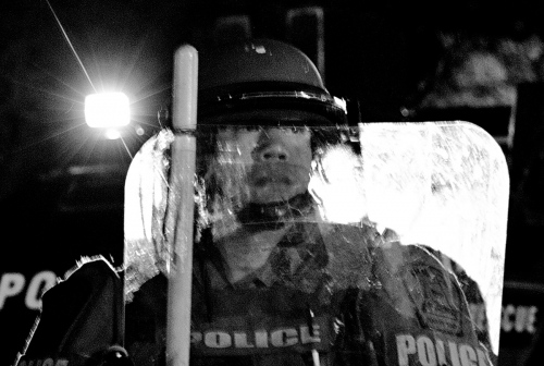 Baltimore, MD-Police in riot gear demanding the protesters to go home after the 10:00 PM curfew.