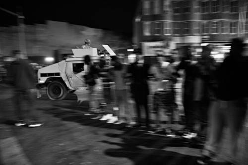 Baltimore, MD- Residents joining arms to create a buffer between the National Guard and the protesters after the 10:00 PM curfew.