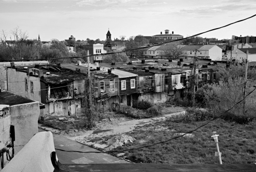 Baltimore, MD- The neighborhood around where Freddie Gray was arrested consist of row houses where 1/3 of the properties are abandoned, boarded up, condemned or burnt down. Although none of this prevents residents to live in these row houses.