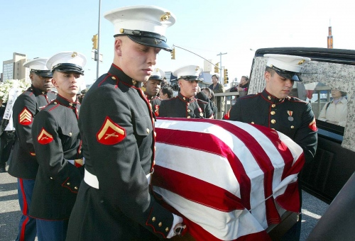 U.S. Marine pallbearers carry the flag drapped casket with U.S. Marine Lance Corporal Patrick Lam body during a burial ceremony in Queens, New York.