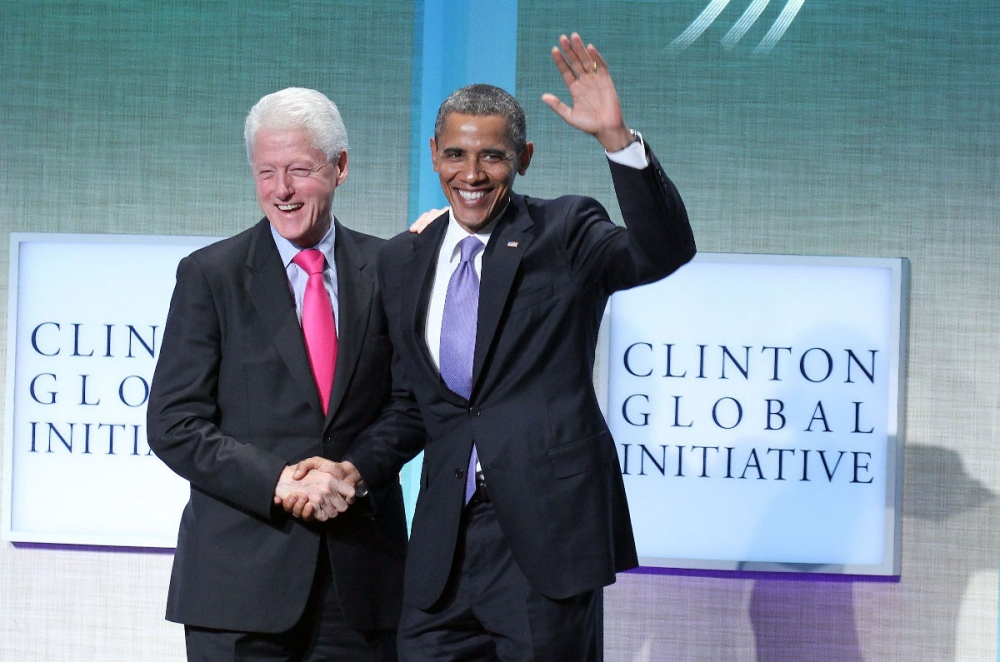 Former President Bill Clinton greets President Obama during the Clinton Global Initiative meeting in New York.
