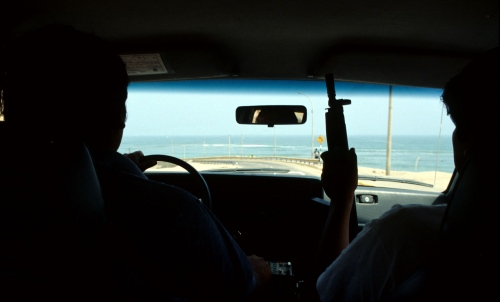 Peruvian Secret Service officers keep an watchful eye in LIma, Peru.