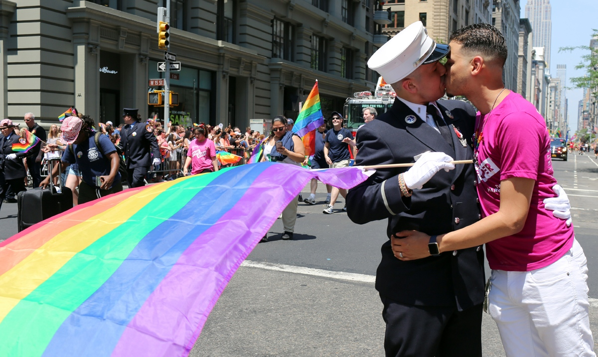Dozens of floats and some 20,000 participants attend the Gay Pride parade, which starts at 36th Street before turning towards the West Village. The march comes at an emotional time, just weeks after a mass shooting at a gay club in Orlando, Fla. On Fifth Avenue, FDNY Lt. Victor Berrios kisses his fiancee Christopher Castro while marching in the parade.