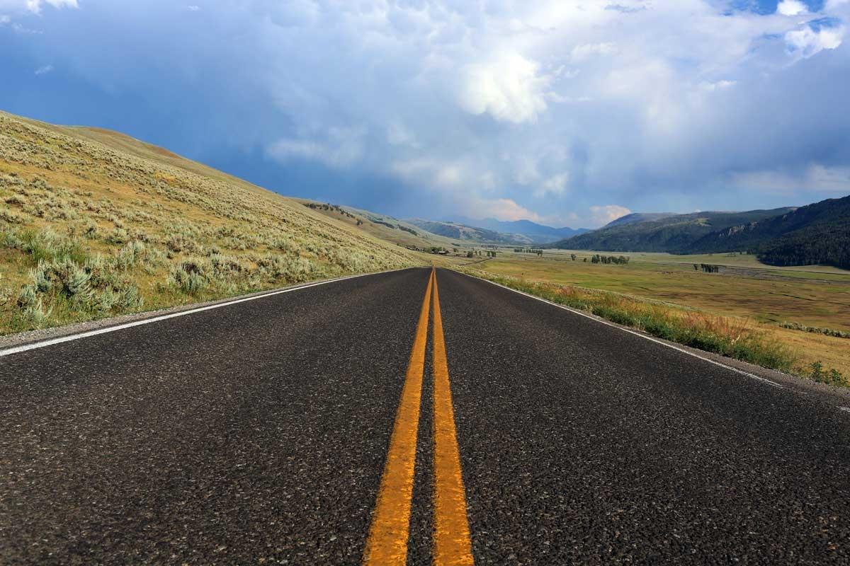 Mountains, plains and open sky are familiar scenes in Montana, pictured is Highway 89 near Corwin Springs.