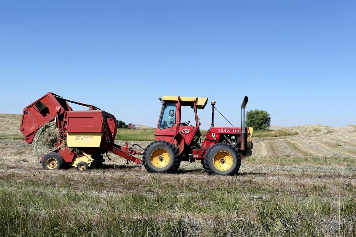 A farm harvest his field of hay near Havre, East Montana. Agriculture is the financial engine that drives Montana's economy, bringing in $2 billion in annual revenue plus associated benefits to rural communities. One in five Montana workers is employed in agriculture or a related field.
