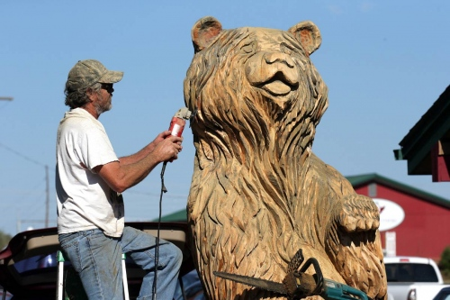 Don McAndrew sculpt a giant wood bear near Bozeman. Carved wood sculptures are common site throughout Montana.