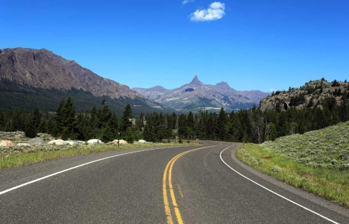 Mountains, plains and open sky are familiar scenes in Montana, pictured is Highway 212 near Cooke City.
