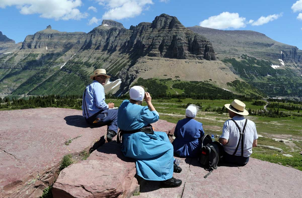 Amish tourists enjoy the views of Glacier National Park near Logan Pass. Montana is home to five Amish communities.