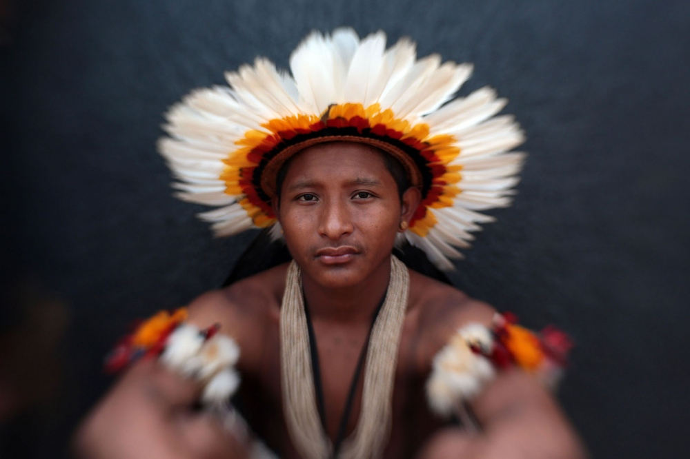 "Oziel Apopi Rikbaktsa - Rikbaktsa - Brazil  The Rikbaktsa live in 3 indigenous land: Erikpatsa, Japuíra and Escondido, all of them located in the county of Juína (MT). According to FUNASA, as of 2010, the total population of this Ethnicity was of 1.324 individuals. The first record of contact with non-indigenous was in 1940 with the arrival of the tappers in the region. They have always protected their lands, and, because of that, were know as warriors. The peaceful relation between indigenous and white people occurred only from 1957 to 1962. They speak the Rikbaktsa language, from the linguistic root Macro-Jê. The self denomination Rikbaktsa means ""the human beings"". But locally they are known as boatmen for their skill with canoes. They are also called ""wooden ears"" for they use big ""botoques"" made of small boxes and inserted into the extended lobe of the ears."