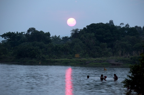 Indigenous people swim on the Tocantins River in Palmas, Brazil during the first Indigenous Peoples Games.