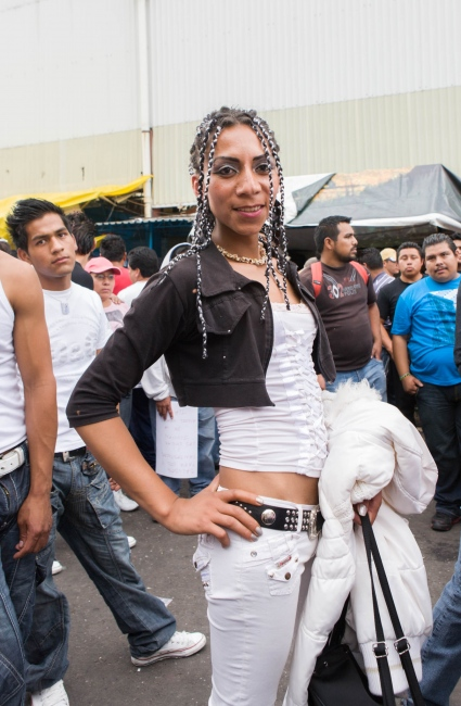 · Transexual dancer in the Merced market annual celebration. The LGBBT community is a fundamental part of the sonidero parties since they coordinate the dances presented in circles that open up among the fans. The parties are family oriented and therefore there is no discrimination towards them within the parties they coordinate.  // · Bailarina transexual en el mercado de la merced. Fundamentales en las fiestas sonideras, las bailarinas coordinan las rondas de baile y presentan shows de bailes coordinados. Las fiestas son familiares por lo cual no hay discriminación contra las mismas en comunidad sonidera. Merced, 2009