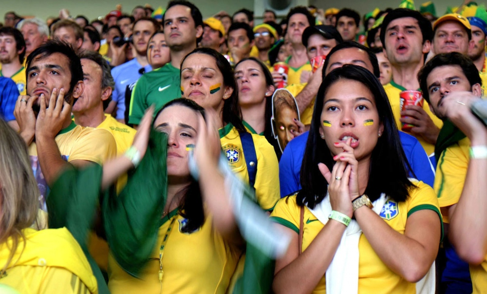 Brazilian fans reacts as the Brazillian national team collapses in front of the German national team in the Mineirão Stadium in Belo Horizonte, Brazil.