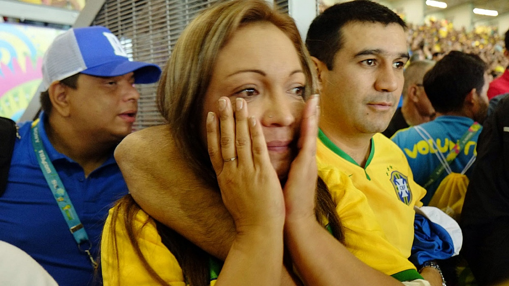 A unidentified woman cries during the Brazilian national team shocking loss.