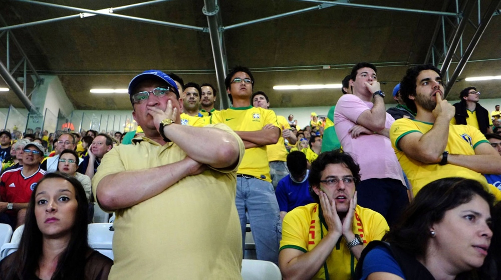Brazilians on the stadium can not believe what is happening on the field below.