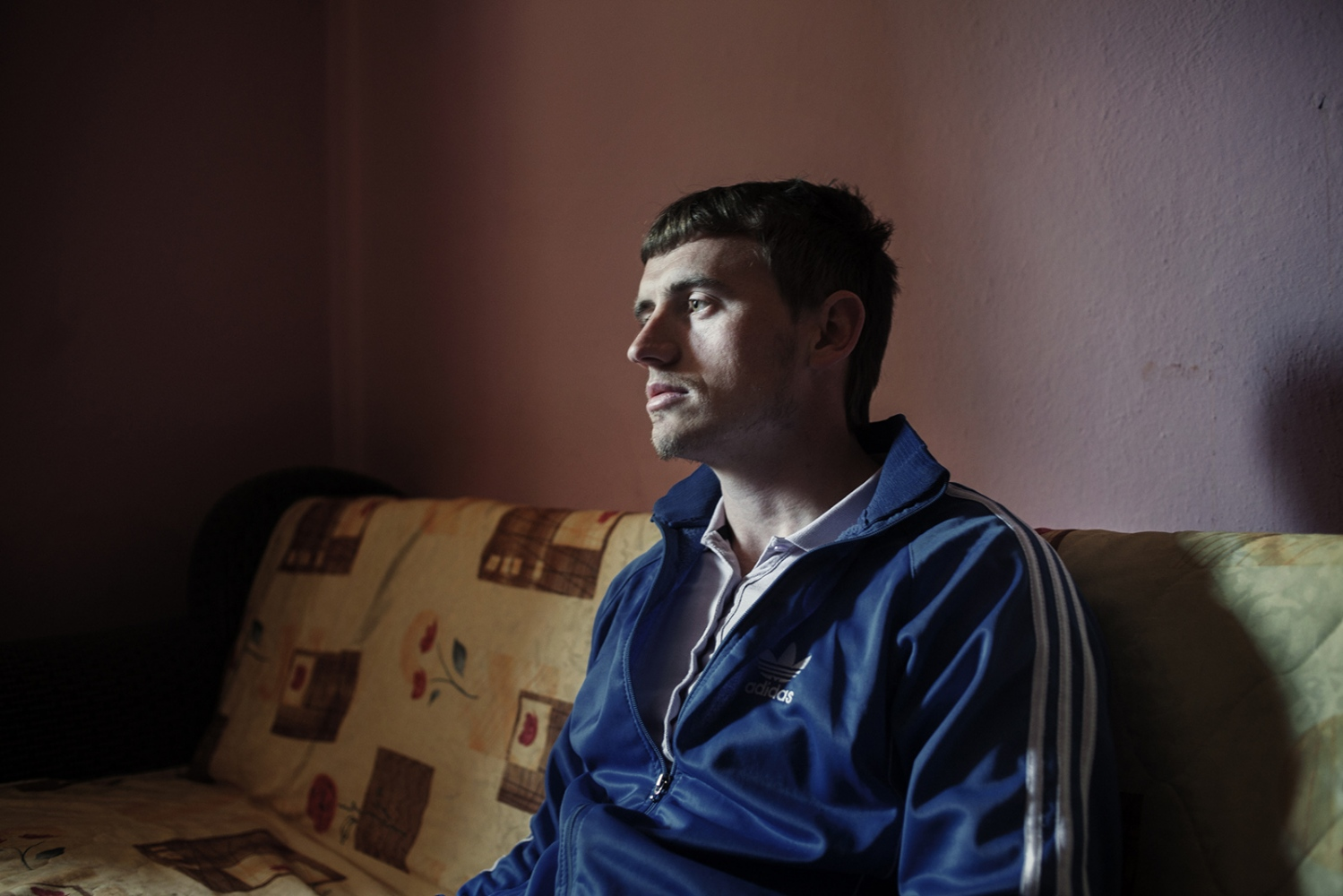 Kosova, Peja, 2012: Ardian Hoxha in seen in his living room. He's 22 years oldand he studies law at University of Pristina.