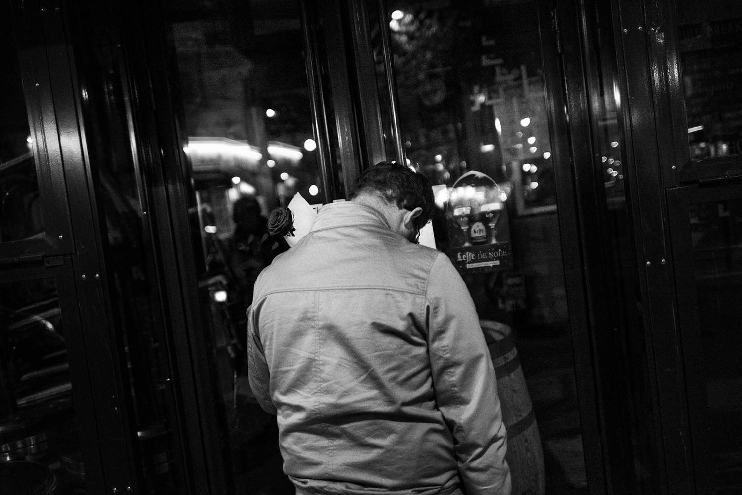 Man lay a rose at the entrance of the Brasserie Comptoir Voltaire.Paris, France, Place de la Republique. 14/11/2015. The aftermath of the terrorism attacks in Paris on 13/11/2015. At approximately 21:40, on the boulevard Voltaire in the 11th arrondissement, near the place de la Nation, a man sat down in the Comptoir Voltaire cafÈ and placed an order before detonating his suicide vest, killing himself and injuring fifteen people, one of them seriously.