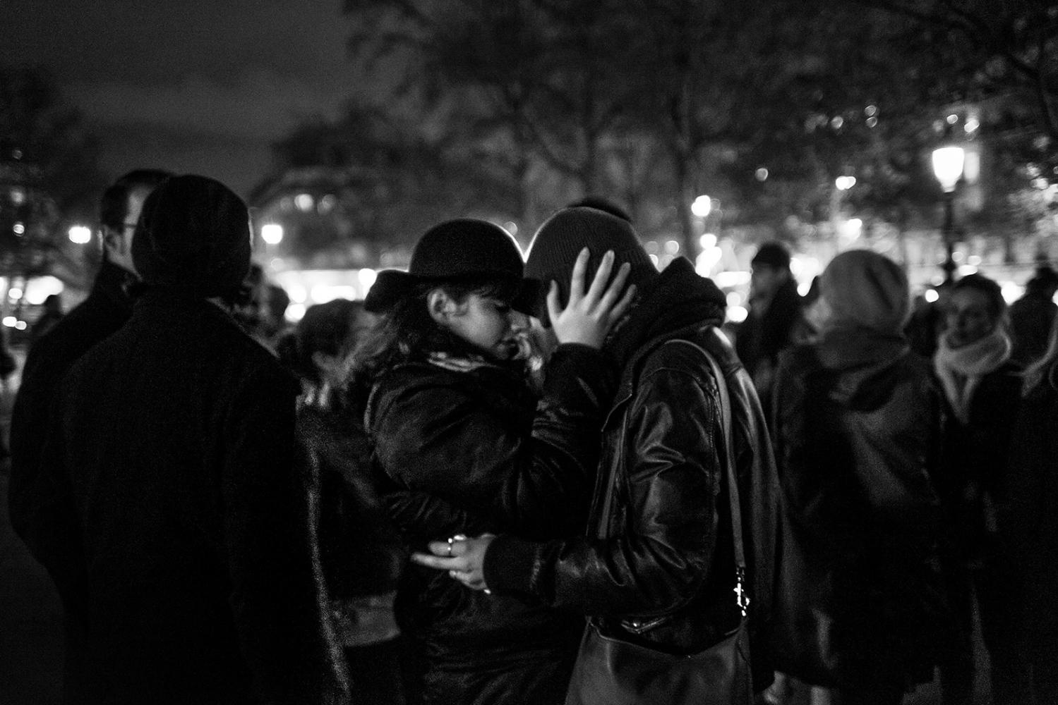 People gather and mourn in front of the statue in Place de la Republique. Paris, France, Place de la Republique. 14/11/2015. The aftermath of the terrorism attacks in Paris on 13/11/2015. Despite the ban on public meetings, many people gathered at the Place de la Republique to commemorate the victims of the terrorist attacks.