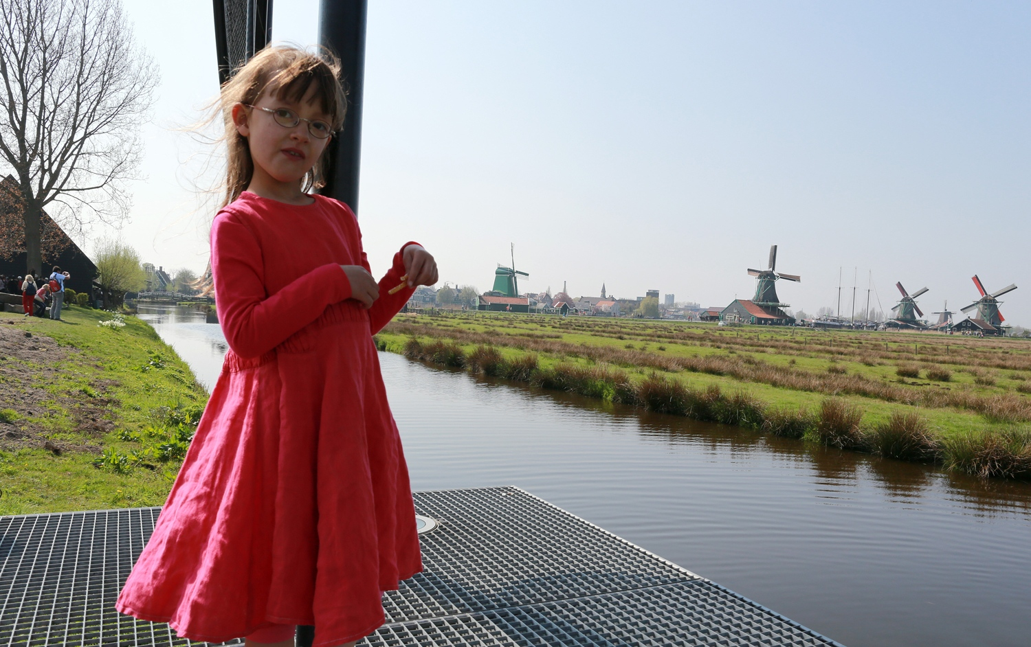 Five years old Hannah Doornenbal pauses from playing with her sisters near a dyke overlooking the Zaanse Schans a fully inhabited, open-air conservation area and museum a few miles north of Amsterdam.