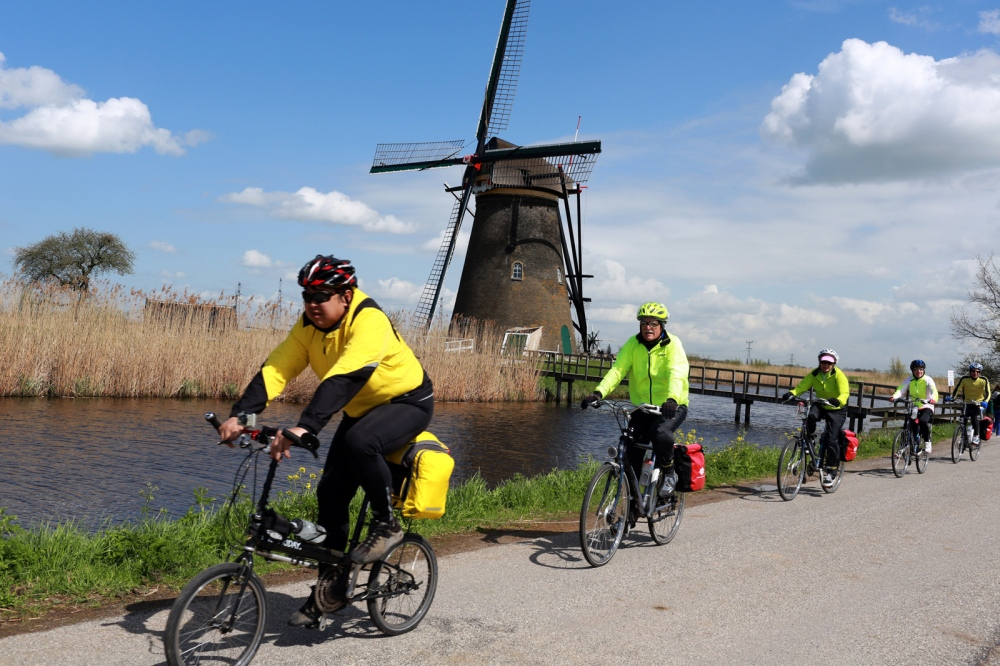 Cycling in Kinderdijk the most famous group of polder mills and World Heritage listed. In the Netherlands cycling is a common and popular method of transport and recreation, accounting for 27% all trips nationwide, and up to 59% of all trips in its cities. Tourists also like to cycle around the countryside or the city.