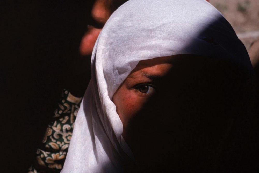Kabul, 1998. A young girl at a widows' bakery.