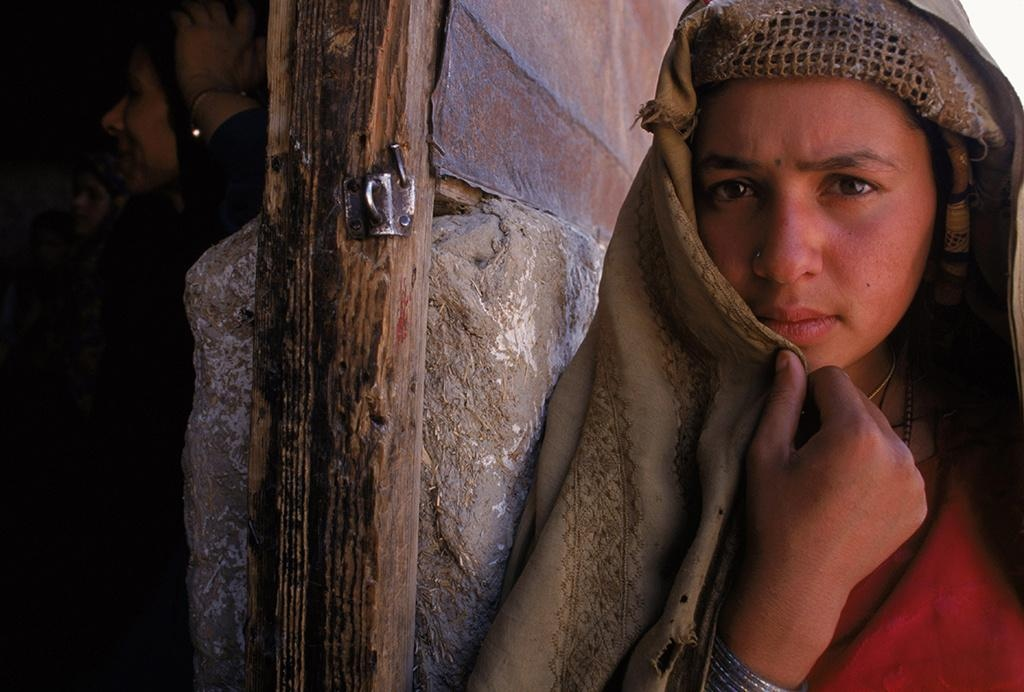Kabul, 1998.   A young woman outside a widows bakery.